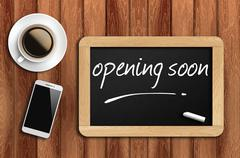 coffee, phone  and chalkboard with word opening soon - stock photo