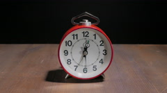 Timelapse alarm clock on a black background directly 4k Stock Footage