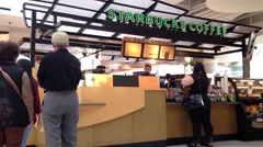Customer line up for buying coffee Stock Footage
