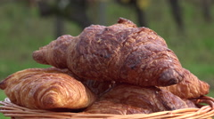 Stock Video Footage of French croissants in a rotating basket