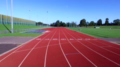 4K Drone footage of large modern running track & surrounding area Stock Footage
