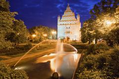 Park and Collegium Maximum by Night in Torun - stock photo