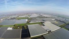Aerial greenhouses drone ascending into the industrial farm area 4k - stock footage