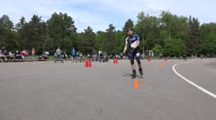 Stock Video Footage of Amateur roller skater relay race participants at finish. 4K