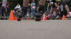 Roller skaters ride on one wheel slalom and people audience. 4K Stock Footage
