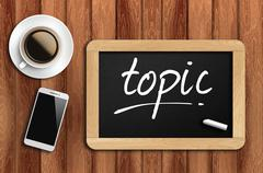 Coffee, phone  and chalkboard with  word topic Stock Photos