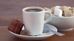 Espresso coffee, sugar and small cake Stock Footage