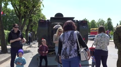 People with children interested military vehicle light tank. 4K Stock Footage