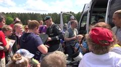 Policeman show police equipment shield helmet truncheon for children. 4K Stock Footage