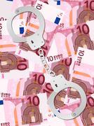 handcuffs on ten euro background vertical - stock illustration