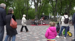 Old man with accordion and drum play music in free event. 4K Stock Footage