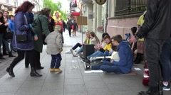 student musician group prepare for show on street for people. 4K - stock footage