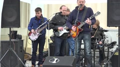 Middle age men group with guitars sing poetry. 4K Stock Footage
