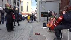 Brother and sister play with violoncello at street. 4K Stock Footage