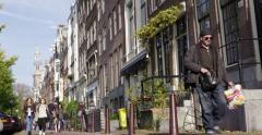 Amsterdam Jordaan canal street Stock Footage