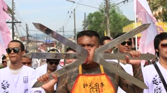 Thai man with a sword in his cheek at the Vegetarian Festival. Phuket, Thailand Stock Footage