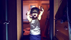Walking undead zombie girl possessed with evil attacks the camera corridor night Stock Footage