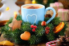 Good morning concept - cup of frothy coffee and a decorated Christmas wreath Stock Photos