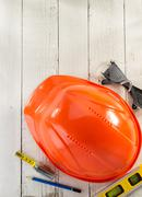 Hardhat and safety glasses on wood Stock Photos