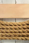 ship rope on wood - stock photo