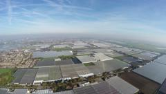 Aerial footage large greenhouse area showing an overview of glass farms 4k Stock Footage