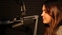 Stock Video Footage of Beautiful Radio DJ in studio