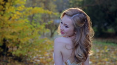Beautiful autumn woman in golden park Stock Footage