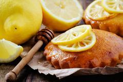 Aromatic homemade lemon cake with honey decorated with grilled lemon slices i - stock photo
