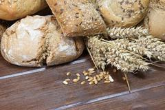 Wholemeal pastries, ears and grain of the wheat Stock Photos