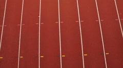 4K Aerial view of track athletes at running track, competing in a race - stock footage