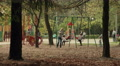 Children on the swing. Autumn daytime. Smooth dolly shot. Footage