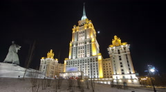 Hotel Ukraine winter night timelapse hyperlapse with Shevchenko monument on Stock Footage