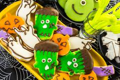 Variety of sweets prepared as Halloween treats - stock photo