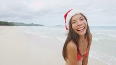 Christmas Santa hat bikini woman on beach vacation holidays getaway - stock footage