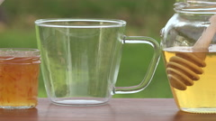 Tea poured into cup - stock footage