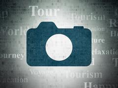 Stock Illustration of Vacation concept: Photo Camera on Digital Paper background