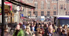 Amsterdam, crowd of Netherlands people walking city center Stock Footage