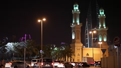 Traffic in front of the mosque in Bahrain Stock Footage