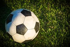 Old Ball in Grass Field - stock photo