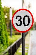 Speed Limit Sign on Street - stock photo