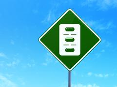 Healthcare concept: Pills Blister on road sign background - stock illustration