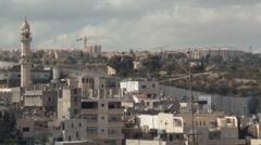 Stock Video Footage of Palestinian West Bank refugee suburb alongside Israeli Separation Barrier