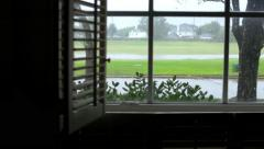 walk to window showing storm outside - stock footage