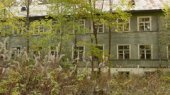Overgrown house in the forest. Autumn daytime. Smooth dolly shot. Stock Footage