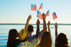 People waved American flags. - stock photo