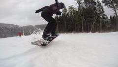 Snowboarding ollie regular with selfie stick - stock footage