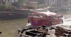 Sightseeing boat canal Amsterdam Netherlands Stock Footage