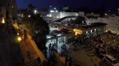 Masses of people walking towards the western wall (time lapse) 2.7k - stock footage