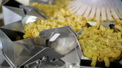Short pasta dropping from an automated machine. Stock Footage