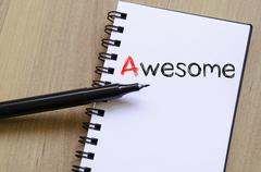 Awesome write on notebook - stock photo
